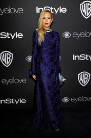 Rachel Zoe looked regal wearing this richly textured purple gown at the InStyle and Warner Bros. Golden Globes post-party.