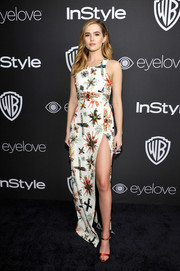 Red satin sandals by Giuseppe Zanotti polished off Zoey Deutch's fabulous look.