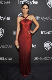 Emmanuelle Chriqui made a breathtaking choice with this ruby-red halter gown by Maria Lucia Hohan for the InStyle and Warner Bros. Golden Globes post-party.