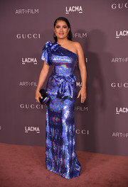 Salma Hayek electrified in this iridescent blue one-shoulder gown by Gucci at the 2017 LACMA Art + Film Gala.