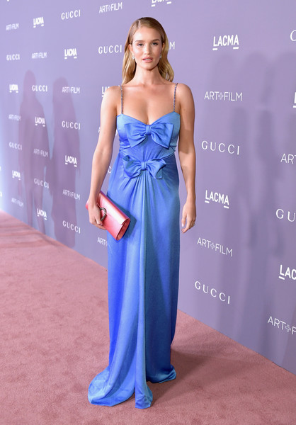 Rosie Huntington-Whiteley's pink satin clutch and blue gown, both by Gucci, made a gorgeous color pairing!
