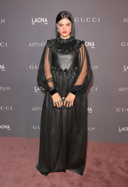 SoKo was a goth queen in a black Gucci leather gown with sheer sleeves and ruffle detailing at the 2017 LACMA Art + Film Gala.