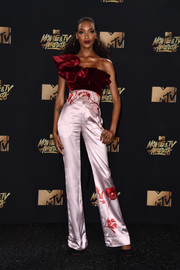 Jourdan Dunn oozed feminine appeal in an asymmetrical velvet ruffle top by Johanna Ortiz at the 2017 MTV Movie and TV Awards.