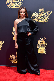 Kat Graham hit the 2017 MTV Movie and TV Awards wearing a baggy black one-shoulder jumpsuit by Off-White.