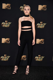 Peyton List coordinated her look with a pair of black T-strap sandals.