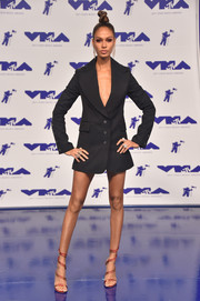 Joan Smalls styled her dress with red multi-strap sandals by Gianvito Rossi.