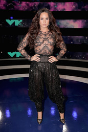 Demi Lovato looked provocative in a sheer black lace bodysuit by Zuhair Murad Couture at the 2017 MTV VMAs.