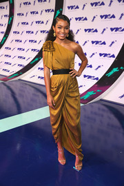 Yara Shahidi polished off her look with strappy silver sandals by Giuseppe Zanotti.