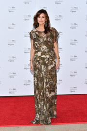 Gina Gershon attended the 2017 Metropolitan Opera opening night wearing a floaty floral gown.