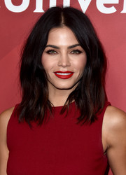 Jenna Dewan-Tatum coated her lips a rich red hue to match her outfit.