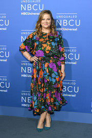 Amy Poehler was spring-chic in a multicolored floral dress at the 2017 NBCUniversal Upfront.