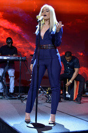 Bebe Rexha performed at the 2017 PTTOW! Summit wearing a long-sleeve cobalt jumpsuit.