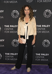 For an elegant finish, Minnie Driver accessorized with a crystal-embellished satin clutch.