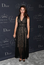 Kristin Davis matched her dress with a pair of black lace pumps.
