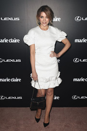 Dannii Minogue paired her LWD with basic black pumps.