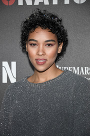 Alexandra Shipp attended the 2017 Roc Nation pre-Grammy brunch wearing her hair in short curls.