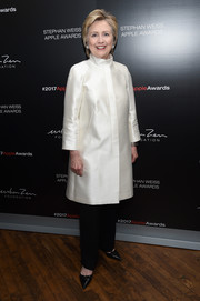 Hillary Clinton looked very refined in a white funnel-neck silk coat at the 2017 Stephan Weiss Apple Awards.