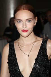 Madeline Brewer sported a neat chignon with an off-center part when she attended the TCA Awards.