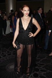 Madeline Brewer flaunted her cleavage and legs in a black Thai Nguyen Atelier gown with a plunging, beaded bodice and a mesh skirt at the TCA Awards.