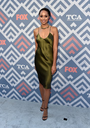 Amber Stevens West attended the 2017 Summer TCA Tour looking seductive in an olive-green slip dress.