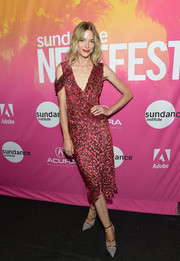 Jaime King completed her outfit with strappy gray pumps by Malone Souliers.