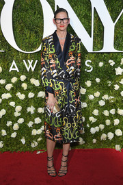 Jenna Lyons went for a sexy finish with a pair of black multi-strap sandals by Rochas.