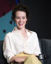 Claire Foy kept it low-key in a cream-colored button-down at the TIFF press conference for 'Breathe.'