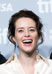 Claire Foy attended the TIFF press conference for 'Breathe' wearing her hair in a messy updo.