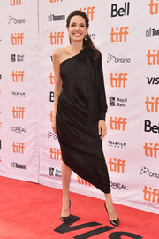 Angelina Jolie was all about understated elegance in a black Ralph & Russo one-shoulder dress with bow detailing at the TIFF premiere of 'First They Killed My Father.'