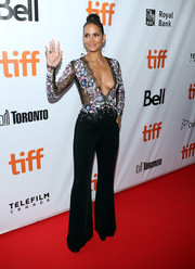 Halle Berry looked va-va-voom in a Zuhair Murad jumpsuit with a plunging neckline and a see-through bodice at the TIFF premiere of 'Kings.'