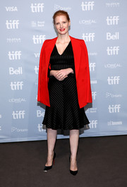 Jessica Chastain slung a fire engine-red blazer over her shoulders for a bright pop to her LBD.