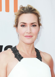 Kate Winslet attended the TIFF premiere of 'The Mountain Between Us' wearing her hair in a messy updo.