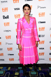 Priyanka Chopra couldn't be missed in her neon-pink Fendi skirt suit at the TIFF premiere of 'Pahuna: The Little Visitors.'