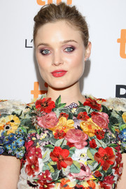 Bella Heathcote's lipstick perfectly complemented the pops of red on her dress!