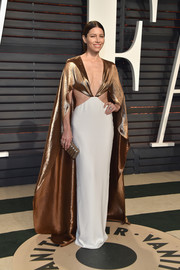 Jessica Biel went full-on diva glamour in a caped gold and white cutout gown by Ralph Lauren at the Vanity Fair Oscar party.