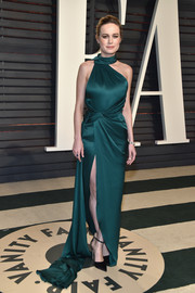 Brie Larson went for modern glamour in an asymmetrical emerald halter gown by Ralph & Russo Couture at the Vanity Fair Oscar party.