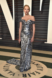 Teresa Palmer radiated in a Vivienne Westwood Couture off-the-shoulder gown rendered entirely in silver and black sequins during the Vanity Fair Oscar party.