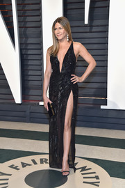 Jennifer Aniston displayed an eyeful of skin in a high-slit, plunging beaded gown by Atelier Versace at the Vanity Fair Oscar party.