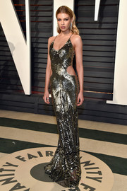 Stella Maxwell was a standout in her high-shine Roberto Cavalli cutout gown at the Vanity Fair Oscar party.