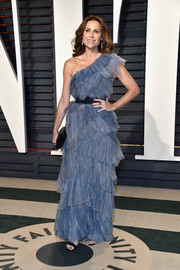 Minnie Driver captivated in a tiered blue one-shoulder gown by Vionnet at the Vanity Fair Oscar party.