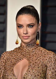 Adriana Lima styled her hair into a tight ponytail for the Vanity Fair Oscar party.
