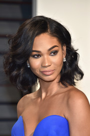 Chanel Iman completed her look with a pair of emerald-cut diamond studs by Neil Lane.