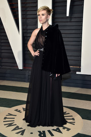 Scarlett Johansson went for goth glamour in a draped black halter gown by Azzedine Alaïa at the Vanity Fair Oscar party.