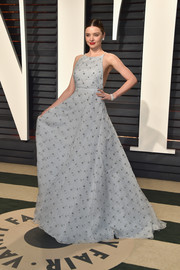 Miranda Kerr was summer-glam in a backless, embroidered gray gown by Miu Miu at the Vanity Fair Oscar party.