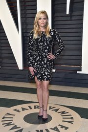 Reese Witherspoon hit the Vanity Fair Oscar party wearing a Michael Kors mini dress embellished with clustered sequins.