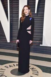 Michelle Monaghan went the edgy route in a long-sleeve black cutout gown by Brandon Maxwell at the Vanity Fair Oscar party.