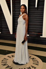 Naomie Harris styled her look with a gold tube clutch by Lee Savage.