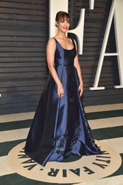 Rashida Jones attended the Vanity Fair Oscar party looking like royalty in this embellished blue ball gown by Prada.