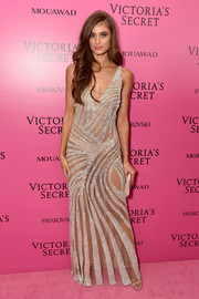 Taylor Hill oozed sultry glamour wearing this sheer metallic gown by Fabiana Milazzo at the 2017 Victoria's Secret fashion show after-party.