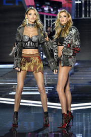 A heavily studded leather jacket finished off Martha Hunt's ensemble.